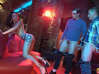 Lola Bulgari gets fucked there a difficulty floor show by twosome horny guys