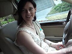 Pretty brunette masturbates in the car during driving